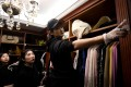 A team of home organisers tidy the luxury wardrobe of a client in Beijing. Photo: AFP