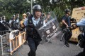 Protesters clash with police in Sheung Shui on July 13, 2019. Officers were among the targets of doxxing, the publishing of personal information on the internet with malicious intent. Photo: Getty Images