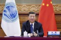 President Xi Jinping addresses the Shanghai Cooperation Organisation summit via video link from Beijing on Tuesday. Photo: Xinhua