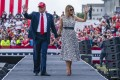 Waving goodbye? President Donald Trump and first lady Melania might soon be out of the White House, but they definitely aren't out of the spotlight. Photo: Reuters