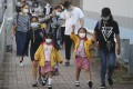 Children being picked up from kindergartens in Kowloon Tong on November 12. The government has announced a 14-day suspension of face-to-face teaching at all kindergartens and day-care centres from Saturday amid an outbreak of upper respiratory infections. Photo: Edmond So