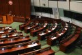 Seats on the pan-democratic side of the Legco chamber sit empty on Thursday after the body's opposition bloc resigned en masse. Photo: Dickson Lee