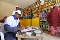 An online shop team records food orders transmitted with the World Food Programme in Wadajir district of Mogadishu, Somalia in October. Photo: Reuters