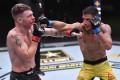 Brazil's Rafael Dos Anjos (right) aims a punch at Paul Felder in their lightweight fight at UFC Vegas 14. Photos: Jeff Bottari/Zuffa LLC