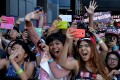 American fans of Korean K-pop group Girl's Generation scream as they appear on the red carpet during K-CON 2014 at the Los Angeles Memorial Sports Arena. The group's fandom, Sone, is one of many whose members obsessively follow K-pop idols. Photo: AFP