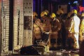 Firefighters investigate the scene of a deadly fire which broke out in a residential building in Yau Ma Tei on November 15. Photo: May Tse