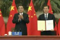 Premier Li Keqiang applauds as Commerce Minister Zhong Shan holds up the agreement during the signing ceremony for the Regional Comprehensive Economic Partnership trade pact on Sunday. China's growing importance in and integration with the Asia-Pacific region requires the United States to reassess its foreign policy. Photo: AFP