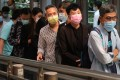 People wearing face masks are seen in Hong Kong's Central district . Photo: K.Y. Cheng