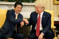 US President Donald Trump shakes hands with then Japanese prime minister Shinzo Abe during their meeting in the White House in Washington in February 2017. Abe's close personal relationship with Trump failed to temper the president's actions on matters of importance. Photo: Reuters