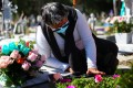 A woman in Mexico visits the grave of her mother, who died of Covid-19 at the age of 86. Photo: Reuters