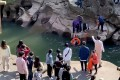 Stephen Ellison, British consul general in Chongqing, rescues a drowning student, who had fallen into a river by accident, at a scenic spot in Chongqing on Saturday. Photo: Reuters
