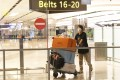 A traveller walks out of the arrival hall after landing at Singapore Changi Airport. Photo: Xinhua