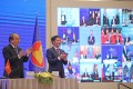 Vietnam's Prime Minister Nguyen Xuan Phuc (left) and Minister of Industry and Trade Tran Tuan Anh celebrate during the virtual signing ceremony for the Regional Comprehensive Economic Partnership in Hanoi on November 15. Photo: EPA-EFE