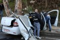 Police inspect the damaged car in Hadath, Lebanon. Photo: Reuters