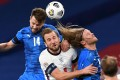 Iceland defender Kari Arnason, England striker Harry Kane and Iceland midfielder Birkir Bjarnason go up for a header during a Uefa Nations League group A2 match. Footballers in England want immediate heading restrictions. Photo: AFP