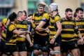Tigers teammates congratulate substitute Craig Lodge after scoring the game-winning try at King's Park. Photo: Ike Images