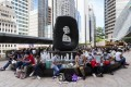 Foreign domestic helpers gather outside Exchange Square in Central, Hong Kong, on Sunday, August 9. The recent trend to vilify historical figures associated with slavery distracts us from redressing abuses today that continue to victimise migrant workers. Photo: Robert Ng