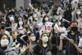 Baseball fans wearing face masks as a precaution against the coronavirus cheer during Game 4 of the Korean Series between Doosan Bears and NC Dinos at Gocheok Sky Dome in Seoul. Photo: AP
