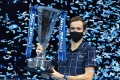 Daniil Medvedev of Russia with his trophy after winning against Dominic Thiem of Austria at the ATP World Tour Finals tennis tournament in London on Sunday. Photo: EPA-EFE