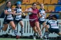 Kowloon winger Anjalika Ybema scores a try against HKFC Ice in round three of the domestic women's rugby league on Saturday. Photo: Ike Images