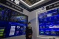 A woman stands in the China Telecom booth at the 7th World Internet Conference on 23 November 2020. Photo: EPA-EFE
