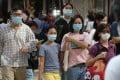 Hongkoners are seen wearing masks in Tsim Sha Tsui on Sunday. Photo: K.Y. Cheng
