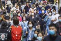 People wearing masks walk on a street in Causeway Bay. Photo: Winson Wong