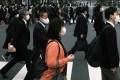 Pedestrians cross a road in Shinbashi, Tokyo. Photo: Bloomberg