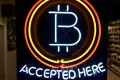 A neon sign at a shop in Hillsboro, Oregon, showing that bitcoin is accepted as payment. Photo: AP