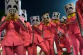 Performers in pig masks take part in the Lunar New Year night parade in Hong Kong last year. Photo: Reuters