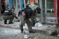 Thai bomb squad officials inspect the site of an explosion in Bangkok in February 2012. File photo: AFP