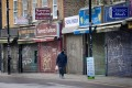 Closed shops in London. Government forecasts put the UK on course for its deepest recession since the Great Frost of 1709. Photo: AFP
