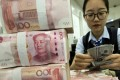 A lower yuan exchange rate figure means it takes fewer yuan to purchase one US dollar, indicating a stronger Chinese currency. Photo: AP