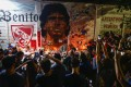Fans hold a vigil for Diego Maradona outside the stadium of Argentinos Juniors, where he started as a professional. Photo: AP