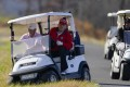 US President Donald Trump gets out of a golf cart at Trump National Golf Club in Sterling, Virginia, on Thursday. Photo: AP