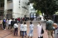 People queue up to get tested for the coronavirus at Yau Ma Tei Community Centre. Photo: Xiaomei Chen