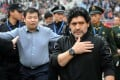 Argentine soccer legend Diego Maradona enters the stadium ahead of a charity football match in Jinan in 2010. Photo: Xinhua