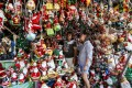 Customers buy Christmas decorations from a Manila street stall in 2018. Photo: AFP