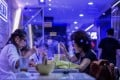 More than 10 staff and customers of three restaurants on Hong Kong Island have been confirmed infected. Photo: AFP