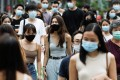 Singaporean pedestrians in the shopping district of Orchard Road. Photo: Reuters