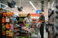 People wear masks while shopping at a Walmart store in North Brunswick, New Jersey, on July 20. Americans already struggling with high unemployment look set to lose what little government aid they have when the Coronavirus Aid, Relief and Economic Security Act expires on December 26, generating more pressure on the Fed to fill the gap with monetary policy. Photo: Reuters