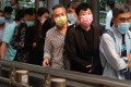 People wearing face masks at lunch time in Central, Hong Kong, in November. Photo: K.Y. Cheng
