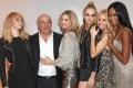 Philip Green with Suki Waterhouse, Kate Moss, Cara Delevingne, Sienna Miller and Naomi Campbell at a private dinner celebrating the Global Launch of the Kate Moss for Topshop Collection at The Connaught Hotel in London in 2014. Photo: Getty Images
