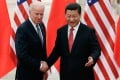 """Chinese President Xi Jinping shakes hands with Joe Biden in Beijing when he was US vice-president in 2013. Observers say the two leaders should hold """"frequent summits"""" to improve ties. Photo: TNS"""