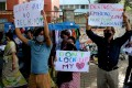 """People from different human rights organizations hold placards during a protest in Bangalore against BJP-lead government and chief minister of Uttar Pradesh over the so-called """"love Jihad"""" law. Photo: EPA-EFE"""