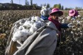 Cotton harveters in a field in northwest China's Xinjiang Uygur autonomous r. On Wednesday, the US said it would block the import of all cotton products made by the Xinjiang Production and Construction Corps, citing concerns the entity is responsible for widespread use of forced labour. Photo: Xinhua