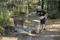 Volunteer Candy Couser feeds a lynx at Carole Baskin's Big Cat Rescue sanctuary near Tampa, Florida, in 2018. Photo: Big Cat Rescue via AP