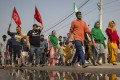 People shout slogans as they join a farmers' protest at the Delhi-Haryana state border. Photo: AP