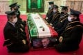 Mourners sit next to the coffin of Iranian nuclear scientist Mohsen Fakhrizadeh during the burial ceremony at the shrine of Imamzadeh Saleh in Tehran in November. Photo: West Asia News Agency via Reuters