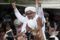 Indonesian Islamic cleric and the leader of Islamic Defenders Front Habib Rizieq Shihab gestures to his followers as he arrives home from Saudi Arabia on November 10. Photo: AP